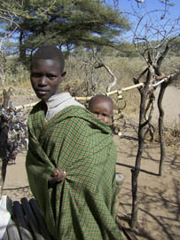 A Datoga woman carries her child