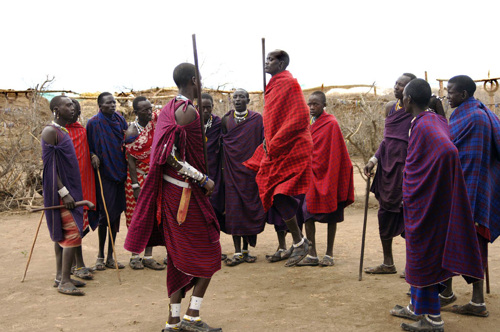 The maasai men perform their traditional Dance